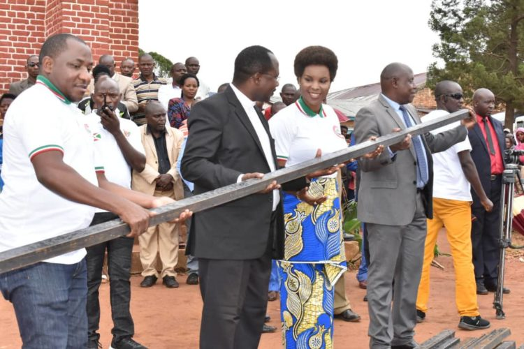 The First Lady assists the Kibumbu Parish with 700 metal tubes